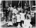 Group of girls in front of house on Alfred Street, Kingston (I0013441).tif