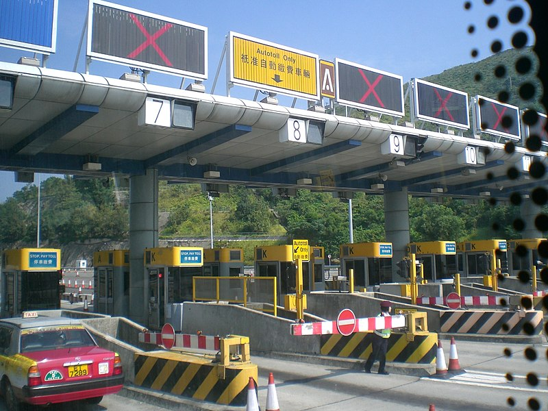 File:HK Toll road gates n Autotoll sign in yellow color.JPG