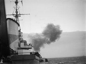 HMS Ajax (22) - Ajax bombards Bardia in Libya in December, 1941