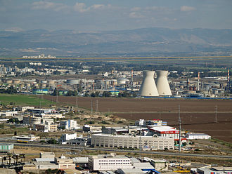 Oil refinery - The oil refinery in Haifa, Israel is capable of processing about 9 million tons (66 million barrels) of crude oil a year.  Its two cooling towers are landmarks of the city's skyline.