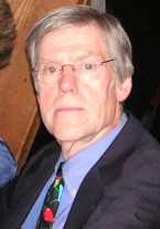 A photograph of a Caucasian senior wearing glasses.