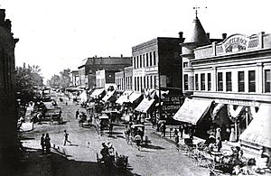 Harrisburg, Illinois - Locust St. crossing at Main St. West side of square in 1910.