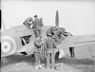"""No. 73 Squadron RAF - A Hawker Hurricane Mark I flown by Flight Lieutenant J E """"Ian"""" Scoular, commander of 'B' Flight, No. 73 Squadron RAF, being refuelled and re-armed between sorties at Reims-Champagne, 1939 or 1940"""