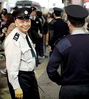 Peaked cap - Hong Kong Hawker Control Officer wearing peaked cap