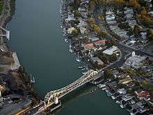 Aerial view of a bascule bridge (drawbridge) spanning the estuary separating Oakland from Alameda.