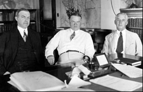 In this 1926 photo, William P. McCracken, assistant secretary of commerce for civil aviation, is shown with Secretary Hoover (center) and assistant secretary of commerce Walter Drake.