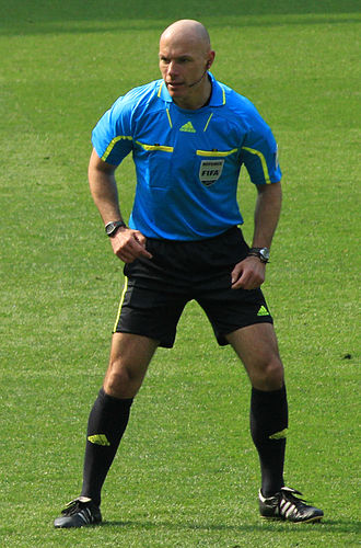 Referee (association football) - Howard Webb officiating a match in 2011