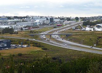 Route 1 (Iceland) - The intersection of Suðurlandsvegur (left) and Vesturlandvegur (lower right) in Reykjavík. The latter continues more than 2 km to the west (far side), before merging with route 49.