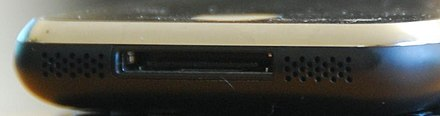One of two speakers (left) and the microphone (right) surround the dock connector on the base of the 1st-generation iPhone. If a headset is plugged in, sound is played through it instead. - iPhone