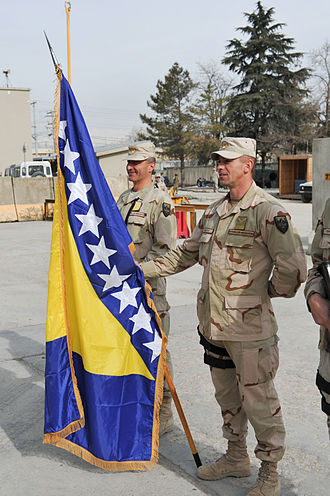 Armed Forces of Bosnia and Herzegovina - ISAF Bosnian troops display their national flag.