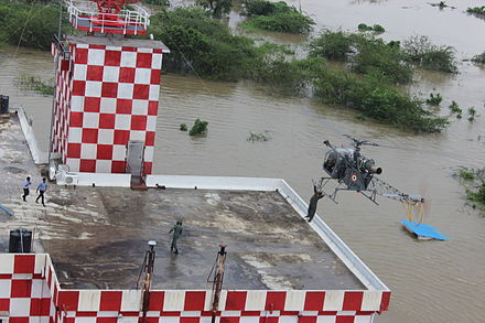 An Indian Air Force helicopter rescues stranded people during 2015 Chennai Floods. Indian Air Force Cheetah helicopters rescue op 2015 Chennai Flood.jpg
