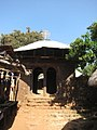 Ingang van een Klooster aan het Tanameer (6821421669).jpg