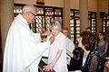 Isabel Akal receives the Benemerenti medal from Mgr. Paul Nadal on her 100th birthday.jpg