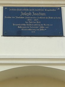 Memorial plaque on his birth house (Source: Wikimedia)