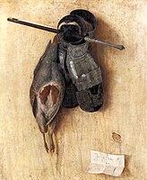 En død fugl og to skinnhansker som henger på en vegg