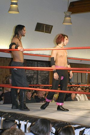 Seth Rollins - Black (left) in the ring along Age of the Fall leader Jimmy Jacobs at a Pro Wrestling Guerrilla event