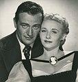 John Wayne-Vera Ralston in Dakota.jpg