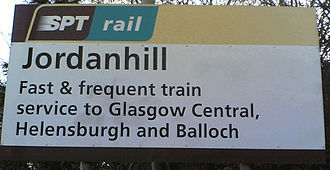 Jordanhill railway station - The name sign identifying Jordanhill station. The sign highlights the primary destinations: Glasgow Central, Helensburgh, and Balloch.