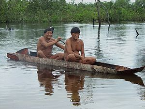 Kalapalo men canoeing.jpg