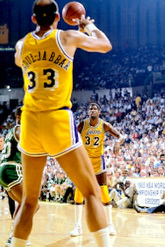 Kareem Abdul-Jabbar - Abdul-Jabbar (33) receiving a pass from Magic Johnson during the 1985 NBA Finals.