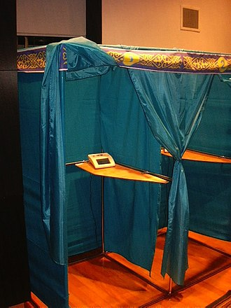 """Elections in Kazakhstan - Voting booths, each with an AIS """"Sailau"""" touch-screen electronic voting machine."""