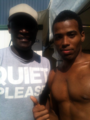 Kelvin Taylor on set of Spartacus Vengeance with Peter Mensah, April 2011.png