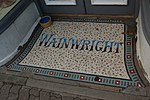 Kington 28 - Wainwright mosaic in shop doorway.JPG