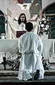 Kneeling at the Altar (7094491169).jpg