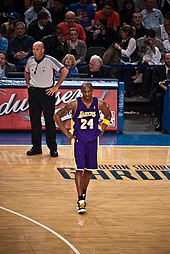 Kobe Bryant, in his Lakers uniform, standing on the basketball court at Madison Square Garden