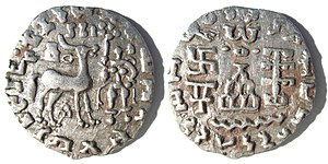 "Kuninda Kingdom - Silver coin of the Kuninda Kingdom, c. 1st century BCE. Obv: Deer standing right, crowned by two cobras, attended by Lakshmi holding a lotus flower. Legend in Prakrit (Brahmi script, from left to right): Rajnah Kunindasya Amoghabhutisya maharajasya (""Great King Amoghabhuti, of the Kunindas""). Rev: Stupa surmounted by the Buddhist symbol triratna, and surrounded by a swastika, a ""Y"" symbol, and a tree in railing. Legend in Kharoshti script, from righ to left: Rana Kunidasa Amoghabhutisa Maharajasa, (""Great King Amoghabhuti, of the Kunindas"")."