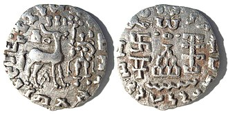 "Kuninda Kingdom - Silver coin of the Kuninda Kingdom, c. 1st century BCE. These coins followed the Indo-Greek module. Obv: Deer standing right, crowned by two cobras, attended by Lakshmi holding a lotus flower. Legend in Prakrit (Brahmi script, from left to right): Rajnah Kunindasya Amoghabhutisya maharajasya (""Great King Amoghabhuti, of the Kunindas""). Rev: Stupa surmounted by the Buddhist symbol triratna, and surrounded by a swastika, a ""Y"" symbol, and a tree in railing. Legend in Kharoshti script, from right to left: Rana Kunidasa Amoghabhutisa Maharajasa, (""Great King Amoghabhuti, of the Kunindas"")."