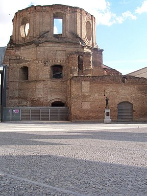 Lavapiés - Ruins of the Escuelas Pías, seen from the Plaza Agustin Lara, name for the Mexican composer whose statue is visible in the photo