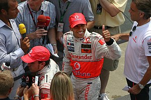 2007 United States Grand Prix - Lewis Hamilton greets press and fans after winning his second race in a row from the pole