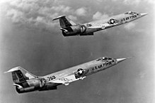 Two F-104s flying in formation