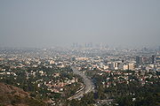 A view of Los Angeles covered in smog from Mulholland Drive