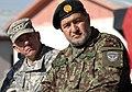 Lt. Gen. Caldwell and Gen. Bismillah Mohammadi listen to a speaker (4251485088).jpg