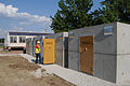 Lucia Gamba, quality assurance specialist with the U.S. Army Corps of Engineers, inspects newly placed storm shelters at the temporary site for Irving Elementary School in Joplin, Mo., July 2, 2011 110702-A-LI404-018.jpg