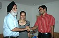 M.S. Gill blessing the Ms. Saina Nehwal, Indian Quarter Finalist, Badminton and her Coach Shri Pullela Gopichand on their return from Beijing Olympics, in New Delhi on August 19, 2008.jpg