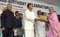 M. Venkaiah Naidu giving away awards for the best service at an event to rededicate Thakkar Bapa Vidyalaya.jpg