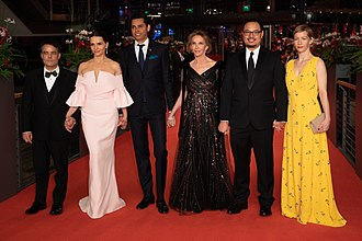 69th Berlin International Film Festival - Main competition jury at the closing ceremony at Berlinale 2019: (from left to right) Sebastián Lelio, Juliette Binoche, Rajendra Roy, Trudie Styler, Justin Chang, and Sandra Hüller.