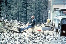 Man sitting at a campsite