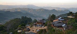 Akha people - The village of Mae Chan Tai in Mae Suai District, Chiang Rai Province, Thailand, is a more modern village. Note the large coffee drying platforms.