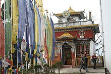 Main Shrine of Pemangytse Gompa with prayer flags.jpg