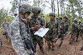 Maj. Prashant Mishra reviews the route for a training patrol with U.S. Army 1st Lt. Alexander Stodola.jpg