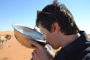 Man drinking camel milk (6486240135).jpg