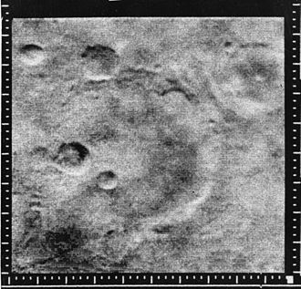 Exploration of Mars - Mariner Crater, as seen by Mariner 4.  The location is Phaethontis quadrangle.
