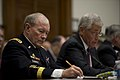 Martin E. Dempsey takes notes as Secretary of Defense, Chuck Hagel testifies before the House Armed Services Committee on the fiscal year 2014 National Defense Authorization Budget Request.jpg