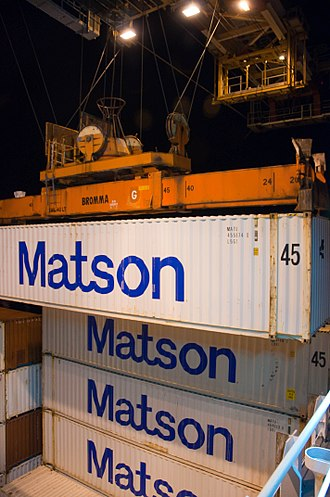 Matson, Inc. - Matson containers being loaded into a ship