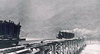 Logging train crossing the Mattole River mouth, circa 1900