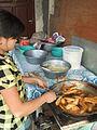 Menggoreng pisang di pasar Rantepao.JPG